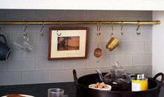 A Kitchen Storage idea - curtain rail and S hooks - beautiful, stylish and oh so useful.....