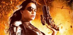 Michelle Rodriguez Packing Heat & Leather on 'Machete Kills' Poster