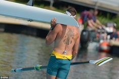 A member of the Australian men's eight rowing crew with a tattoo on his back during a training session at Eton Dorney (Olympic Games London)