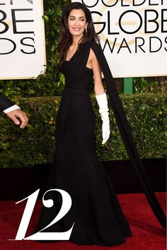 2015 Golden Globes - Amal Clooney in Dior - For her first red carpet debut as a the newlywed, Mrs. George Clooney chose Dior for drama but went for black and white to secure a timeless photo - HarpersBAZAAR.com
