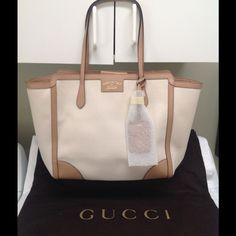 Gucci Swing Tote Medium NWT 100% authentic.  See photo for serial number.  Was purchased from a high end department store.  Come with dust bag, tag and care card.  Has 1 extra large interior zippered pocket.  2 interior open pockets.  All trim and handles are leather.  Removable ID tag with interlocking G detail. Hidden magnetic closure.  Embossed gold Gucci trademark.  NWT.  has never been used.  Absolutely 100% authentic.  Any questions please ask.  The neutral color can go with any outfit…
