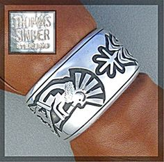 Sterling Silver Cuff bracelet by Famed Navajo American Indian Artist Tommy Singer signed 'Thomas Singer' Sterling 1 3/8 inches wide Kokopelli dancer and large corn stalk.