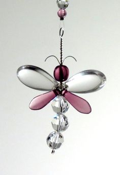 This gorgeous Purple Dragonfly suncatcher / car charm has been hand crafted from Swarovski Crystal and quality Czech glass beads. Each