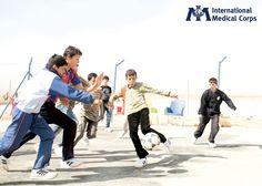 July 2:  Refugee children enjoying a soccer game in Za'atari refugee camp in Jordan. Photo: Cory Eldridge, International Medical Corps, Jordan 2013