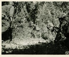 WWII soldiers advance on road block in Central Burma. Photographer Colgate