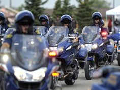 Members of the Michigan State Police Motor Unit arrived