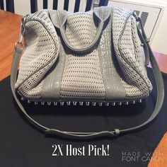 """2X HPAlexander Wang Gray Mesh Rocco with Rhodium """"Classic Chic"""" and """"Essential Style"""" Host Picks! Ladies I'm obsessed with this bag! Grey mesh exterior, rhodium studs and gray leather adjustable strap and handles. Some wear on the handles and piping-please see pictures and I'm happy to answer any questions! Re-poshing so posh already authenticated for me. Ships with Alexander wang dustbag. Truly amazing in excellent condition. Ships same day payment is received with a free purse charm…"""