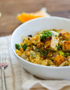 Pumpkin-Pistachio Kale Fried Rice Bowl with Maple Tofu Cubes