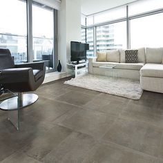 """Big rooms look great with big tile! As seen here with our Icon Olive 24""""x24"""" a lot of tile goes a long way! #tile #tiles #tilefloor #tileaddiction #porcelaintile #floor #floortiles #floortile #living #livingroom #design #designer #interior #interiordesign #chair #architecture #architect #ihavethisthingwithtiles #ihavethisthingwithfloors #tiletuesday #richardsandsterling @tiletuesday by richardsandsterling"""