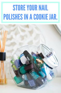 A cute way to display and store nail polishes. -- They sell this exact jar at the container store!  Great at the party!