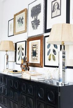 Gallery wall of modern black and white drawings and prints over a mid-century modern console - Galley Wall Ideas & Decor