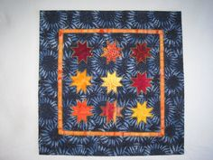 Peekaboo Stars is an art quilt It was made by by bunchberrystudio, $75.00