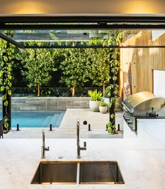 Our Toorak project is Melbourne's dream backyard. Combining a modern outdoor living space with a refurbished in ground concrete swimming pool, the indoor/outdoor space flows seamlessly for a perfect family lifestyle. Swimming Pool Landscaping, Small Backyard Pools, Modern Backyard, Modern Landscaping, Indoor Swimming Pools, Landscaping Design, Garden Landscaping, Modern Outdoor Living, Indoor Outdoor Living