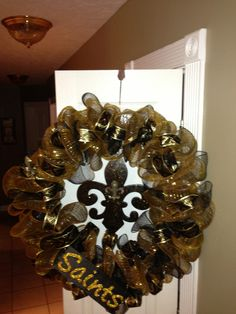 My first attempt at one of these ribbon wreaths.....I had no idea it took SO MUCH RIBBON!  I made this one for a Saints fan.