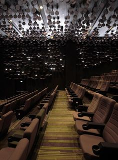 With the advancement of technology, movie screening in cinemas hasbeen digitalized, piles of film reels are no longer stacked up in screeningrooms. In the olden days, screening rooms in cinemas were crammed withflat round metal boxes, where numerous Dine In Theater, Cinema Theatre, Movie Theater, Auditorium Design, Hidden Rooms, Wuhan, Concert Hall, Event Design, Interior Architecture