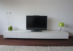 I like this low profile TV console. It is very neutral and can be paired with furniture of varying materials. I also really like the length.