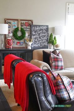 Red & plaid add a Christmas-y feel to any room.  Add a wreath hung on a Christmas card holder, a few small pine potted pine trees and a chalkboard with a seasonal message written in cursive.