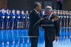 President Barack Obama, left, embraces Secretary of Defense Chuck Hagel during a celebration in honor of Hagel's service, on Wednesday, Jan. 28, 2015, in Fort Myer, Va. Obama, Vice President Joe Biden and top military brass praised Hagel at a farewell ceremony at Joint Base Fort Myer-Henderson Hall. Obama said the country is grateful for military progress on Hagel's watch.(AP Photo/Evan Vucci)