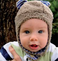 Baby Boys Bear Cub Hat This gorgeous boys bear hat is made from super soft coral velour, with a jersey cotton lining. The side flaps will keep baby's ears warm with a velcro fastener under the chin. Fit most babies up to 12 months.
