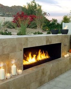 Short Outdoor Fireplace, Gas Fueled Fireplace Modern Fireplace Urban Earth Design Phoenix, AZ i want to make afireplace out of concrete bags stacked chimney too. Modern Outdoor Fireplace, Outdoor Fireplace Designs, Backyard Fireplace, Outdoor Fireplaces, Fireplace Ideas, Fireplace Hearth, Linear Fireplace, Fireplace Stone, Outdoor Stone