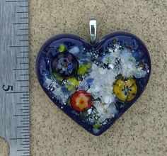 Check out this item in my Etsy shop https://www.etsy.com/listing/451162988/fused-glass-cremation-ashes-pendants