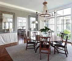 Love the windows in this dining room! - Traditional Home ®/ Photo: Werner Straube
