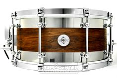 Dunnett Classic Kore Reclaimed Oak/Stainless Snare Drum 14x7 Featuring Tube Lugs, Hypervent, R4 Strainer, Cold Rolled Hoops - includes Ahead Dunnett padded bag! Drum was featured at the 2015 NAMM show, and may show some wear on the head. Purchase Here: http://www.drumcenternh.com/dunnett-classic-kore-reclaimed-oak-stainless-snare-drum-14x7.html