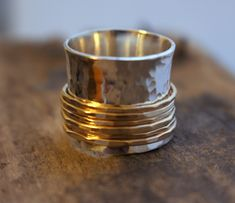 A personal favorite from my Etsy shop https://www.etsy.com/listing/99016860/silver-gold-wide-band-statement-spinner