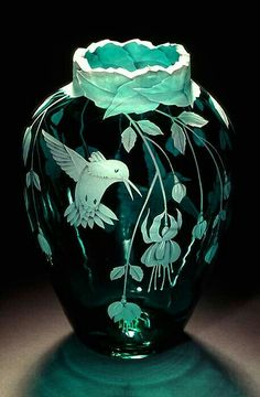 """HUMMINGBIRD~""""The vase is etched with many stems of these delightful flowers hanging down all the way around the piece. I have placed two Hummingbirds on this vase, each hovering at a flower ready to drink its sweet meal. Art Nouveau, Jugendstil Design, Hummingbird Art, Glass Engraving, Art Of Glass, Keramik Vase, Glass Ceramic, Ceramic Art, Glass Etching"""
