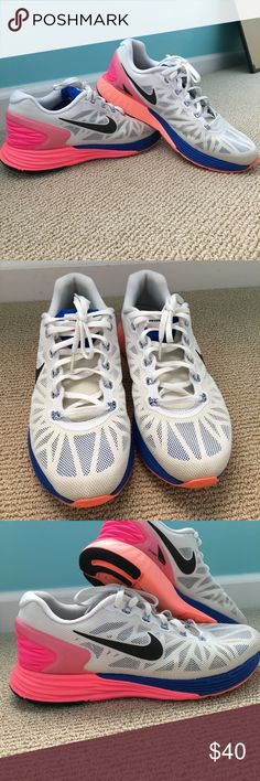 Nike Lunarglide 6 White shoes with pink, orange and blue. Gently used condition. No scuffs. Nike Shoes Sneakers