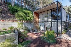 The Eames House, one of the world's most treasured and influential modernist houses, enters a new and improved chapter of conservation as it turns Eero Saarinen, Charles Eames, Architecture Magazines, Art And Architecture, Steel Trusses, Exposed Concrete, Wood Panel Walls, Concrete Planters, Growing Flowers