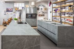 How to Choose the Right Material For Every Surface of Your Home - Photo 12 of 13 - Fusion Zaha Stone kitchen Key Kitchen, Stone Kitchen, Farmhouse Style Curtains, Farmhouse Style Kitchen, Kitchen Images, Kitchen Photos, Wood Sink, Open Cabinets, Kitchen Countertops
