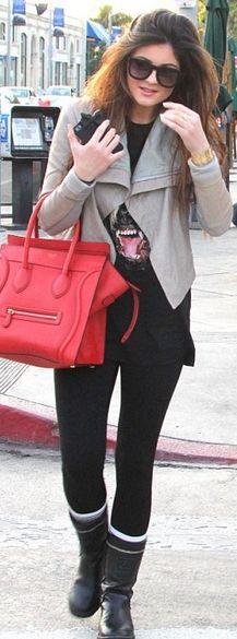 Who made Kylie Jenner's handbag, dog shirt, black boots and leather handbag?