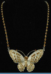Silvertone Butterfly Necklace Accented with Gold Rhinestones $20 @ www.whimzaccessories.com