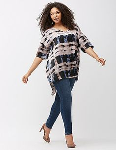 Silky woven tee from Melissa McCarthy Seven7 goes well beyond casual day with a modern print, high-low hem, and front pocket detail. Short sleeves and a flattering V-neck complete the look lanebryant.com