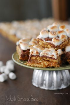 Nutella S'mores Bars: Layers of graham crackers, caramel, chocolate, Nutella and toasted marshmallows!