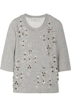 Gray jersey Clear, white and burnt-orange crystals, cream sequins, half sleeves, partially lined Slips on 52% nylon, 48% cotton; lining: 100% cotton Dry clean