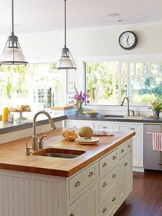 Modern and cottage-style materials come together to create a welcoming kitchen: http://www.bhg.com/decorating/decorating-photos/kitchen/modern-cottage-style/?socsrc=bhgpin020915moderncottagestyle&kitchen