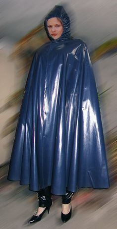 Well dressed for the rain in her long blue pvc cape Vinyl Raincoat, Blue Raincoat, Pvc Raincoat, Plastic Raincoat, Plastic Pants, Capes, Latex Wear, Rain Cape, Rubber Raincoats