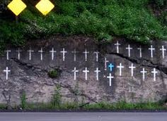 At the bottom of Backbone Mt (aka Bloomington Mtn) in Garrett County, Maryland.  A cross for every death as a result of someone coming down the mountain and slamming into this wall.