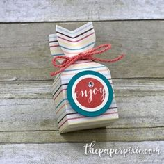 Today's project is a treat holder using the Envelope Punch Board! This treat holder is perfectly sized to fit a Ferrero Rocher chocolate – yummy! I used the adorable Cupcakes & Carousels Designer Ser
