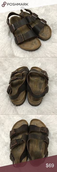 Birkenstock Milano Sandals in Habana color Sz 38 These Birkenstock Milano habana colored sandals are the traditional hard footbed and are a size 38.  They are in good preowned condition with no known flaws and light to medium overall wear.  There is no damage to the soles and I have cleaned and deodorized the foot beds and re-coated the cork with the sealant using the Birkenstock cleaning kit.  They have plenty of life left in them! Birkenstock Shoes Sandals