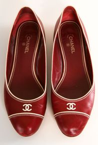 These are very cute shoes but I would hesitate to wear something with such obvious branding on it.