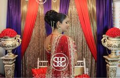 """A side profile shot of Kiran's perfect bride bun. We went for a high detailed traditional bun so her duppatta would drape effortlessly. This was achieved using @bombayhair extensions in 22"""" #blackbeauty and the 25mm Bombay Gold Curling Wand with the @ravbagrymakeupstudio #jumbodonut for that perfect support.  _______________________________________________________  Makeup/Hair/Styling/Photography: Sapphire Studio Ltd.  Snapchat: sapphiredoll8 & mon_b8 For inquiries please email us at…"""
