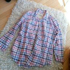 Button Up This plaid button up is perfect for a cool summer day, it has bright colors like blue and pink to make it perfect for the time of the year. Worn twice in a county fair auction. Hollister Tops Button Down Shirts