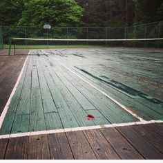 Rare wood court, similar boards to older platform (paddle) tennis courts, and slower than their finished/worn indoor cousins – usually found in city armories.