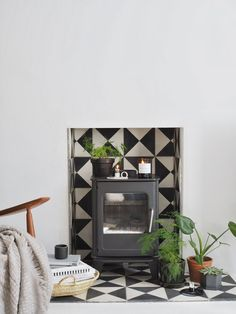 Monochrome tiled fireplace with wood burner. How does our childhood home influence our interior style?