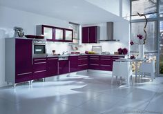 #Kitchen of the Day: A modern kitchen with deep purple cabinets, white walls & floors, and an open plan design. Manufactured by Alno. (Alno.com, Kitchen-Design-Ideas.org)