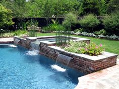 Classic brick and blue stone pool with raised planter and spa set in the pool. - All About Gardens Backyard Pool Landscaping, Backyard Pool Designs, Small Backyard Pools, Swimming Pools Backyard, Swimming Pool Designs, Outdoor Pool, Backyard Ideas, Pool Spa, Raised Pools