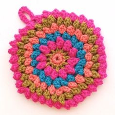 Watch a video tutorial showing you how to crochet a Popcorn Stitch. It's easier than you think.